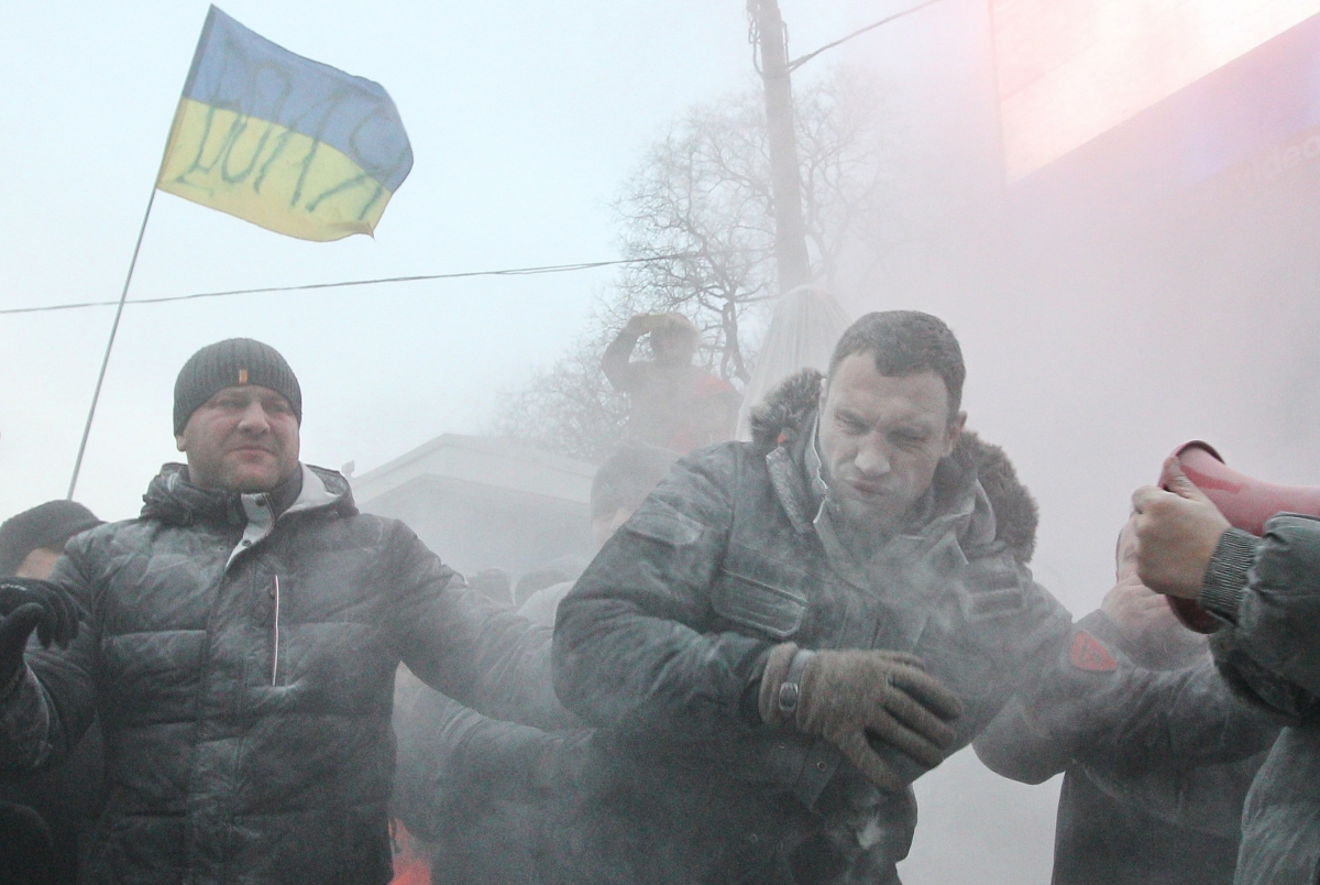 Vitaly Klitschko sprayed with powder during protests in Kiev against Ukraine's direction and new protest laws