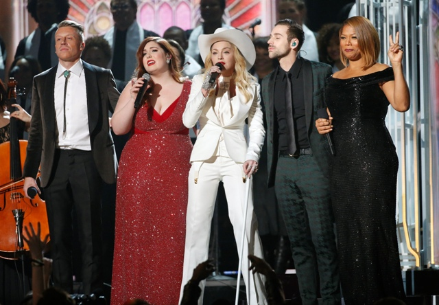 "Macklemore, Mary Lambert, Madonna, Ryan Lewis and Queen Latifah (L-R) perform ""Same Love"" at the 56th annual Grammy Awards"