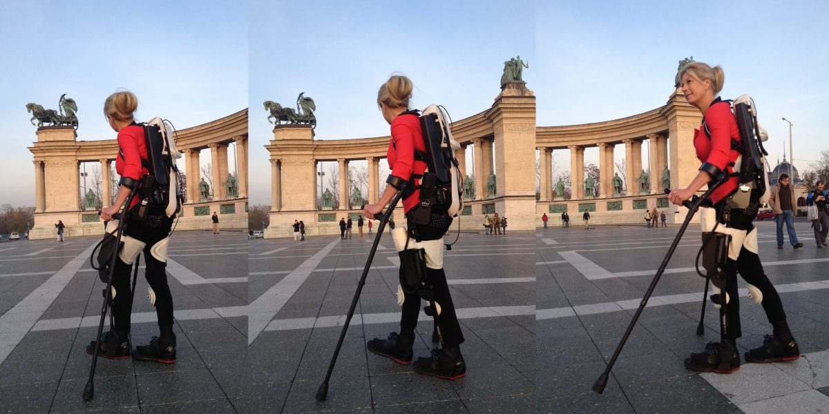 Amanda Boxtel walks in the world's first 3D printed hybrid robotic exoskeleton suit