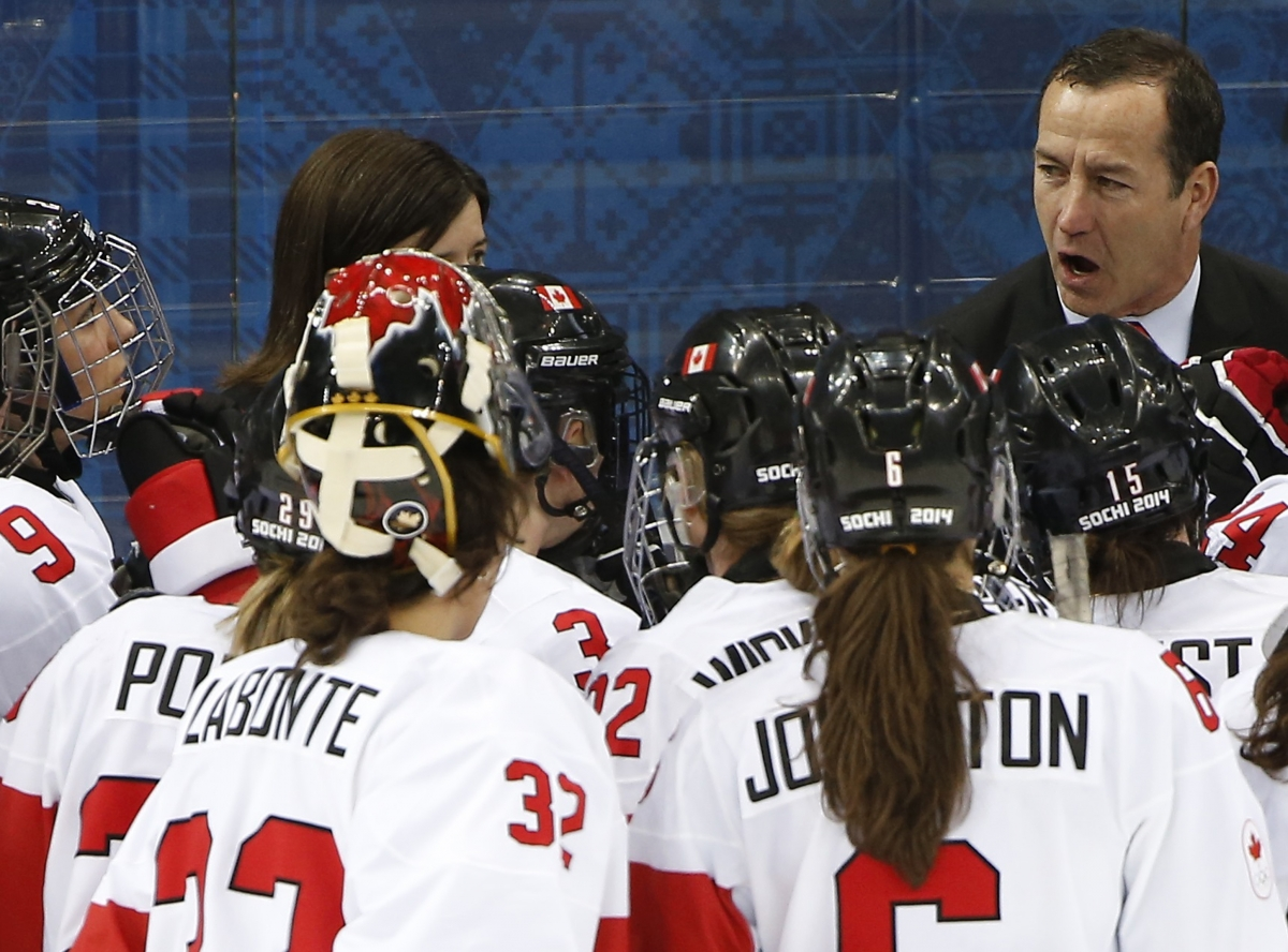Canada head coach kevin dineen talks to his players after semi-final