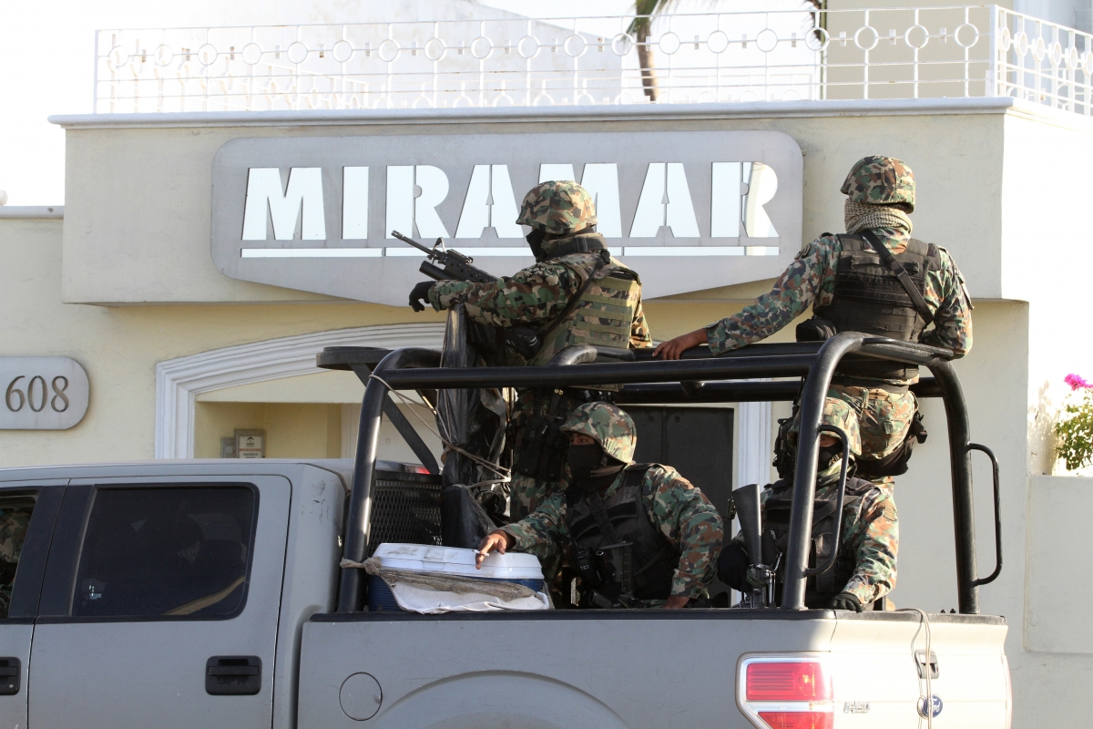 Military personell guard the Miramar complex in Mazatlan, where Guzman was arrested.