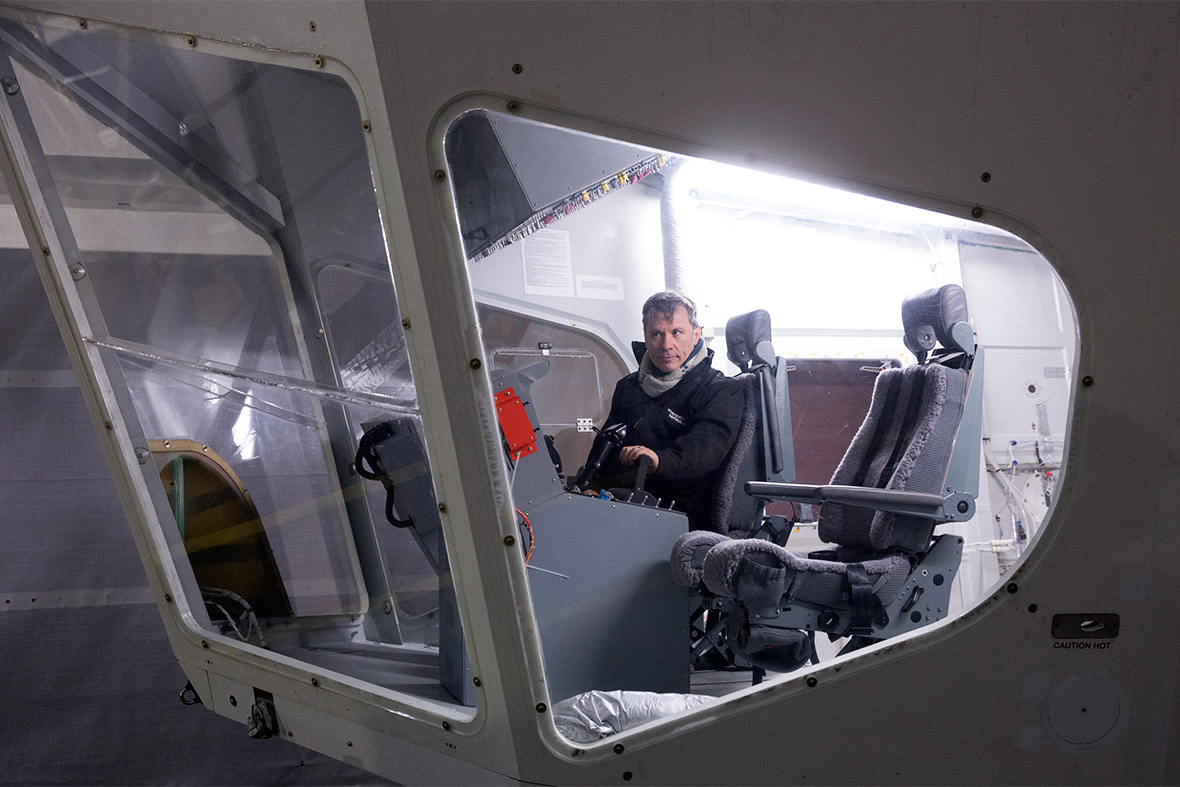 Bruce Dickinson, lead singer of Iron Maiden, sits at the controls on the flight deck of the helium-filled Airlander
