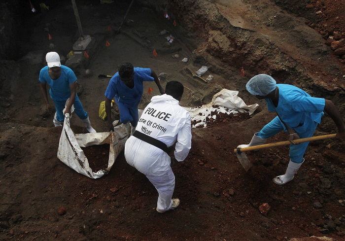 Authorities dig up more than 30 skulls at a construction site in Mannar, northern Sri Lanka.