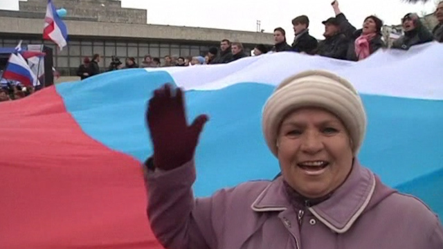 Pro-Russia Crimeans Dance Around Giant Russian Flag
