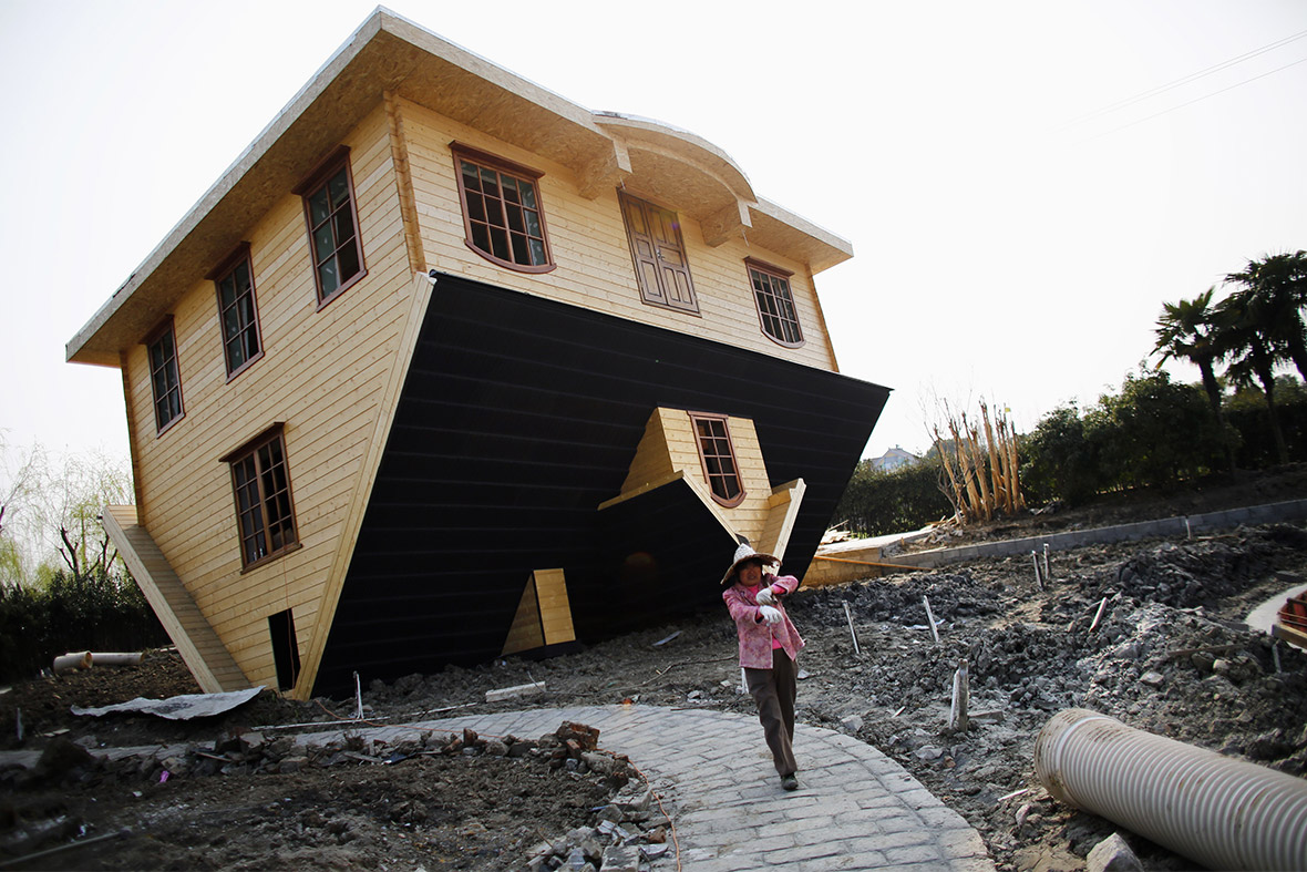 Hot shots photos of the day upside down house overloaded The upside house