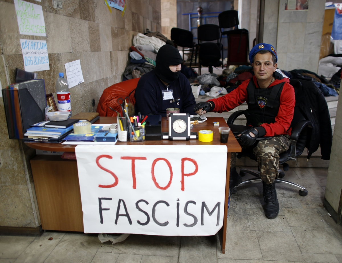 Pro-Russia protesters take a break inside a regional