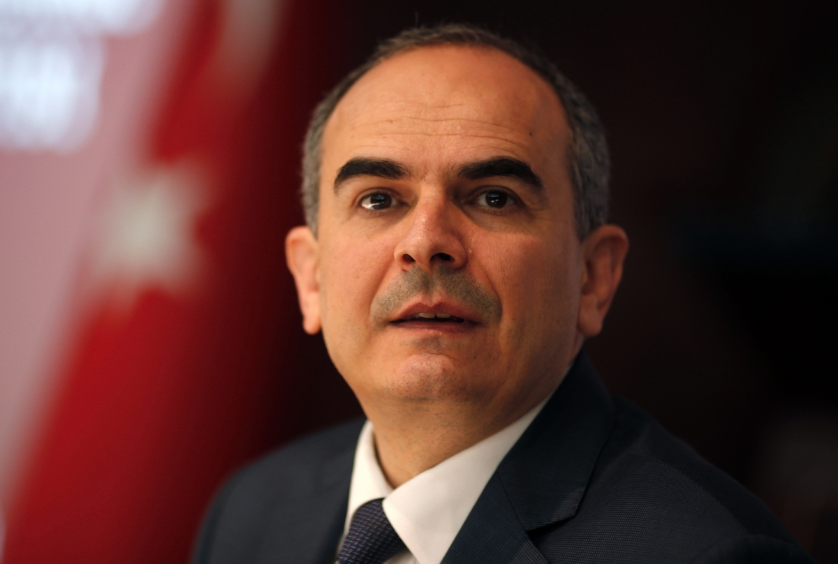 Turkey's central bank governor Erdem Basci addresses the general as