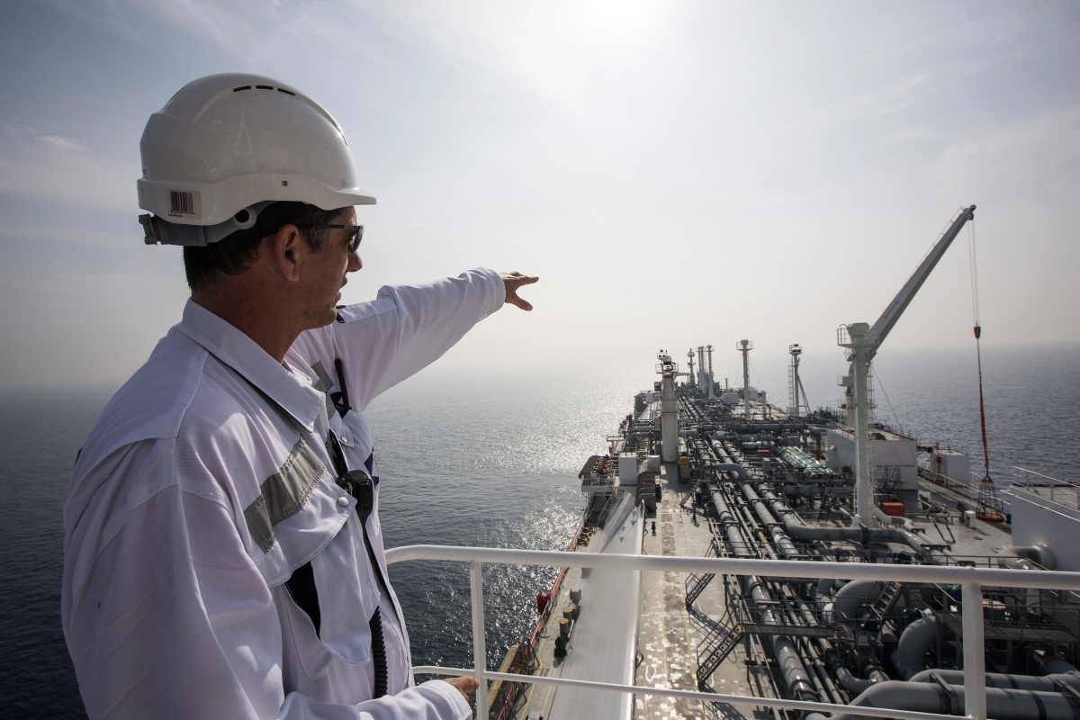 An officer points as he stands on a tanker carrying liquefied natural gas in the Mediterranean, some 10 km