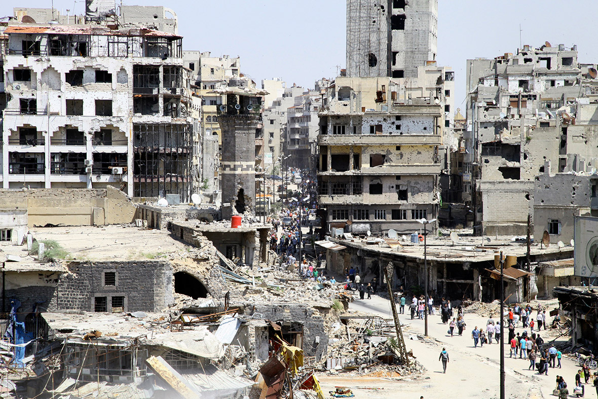 syria residents of homs return to city of rubble. Black Bedroom Furniture Sets. Home Design Ideas