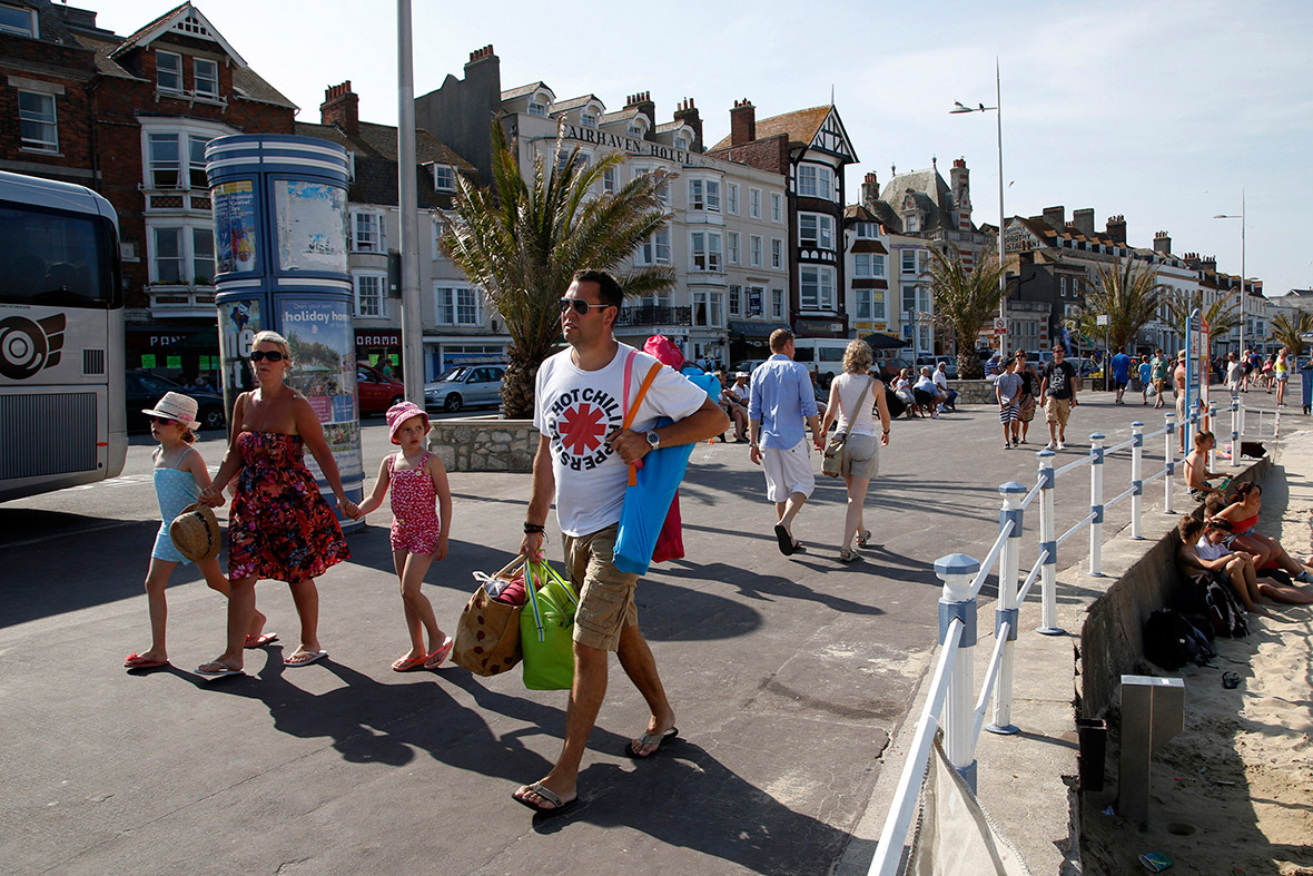 Tourists walk along the beach-front in the Dorset holiday town of Weymouth. The port was the departure point for thousands of Allied troops who took part in the D-Day landings