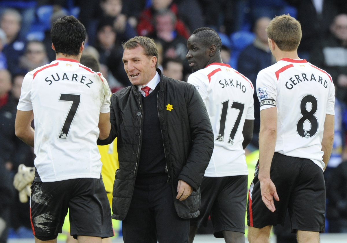 Liverpool's manager Brendan Rodgers (C) congratulates Luis Suarez after scoring a hat