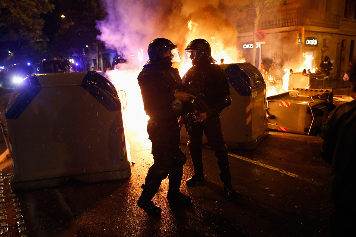 Barcelona can vies police flames