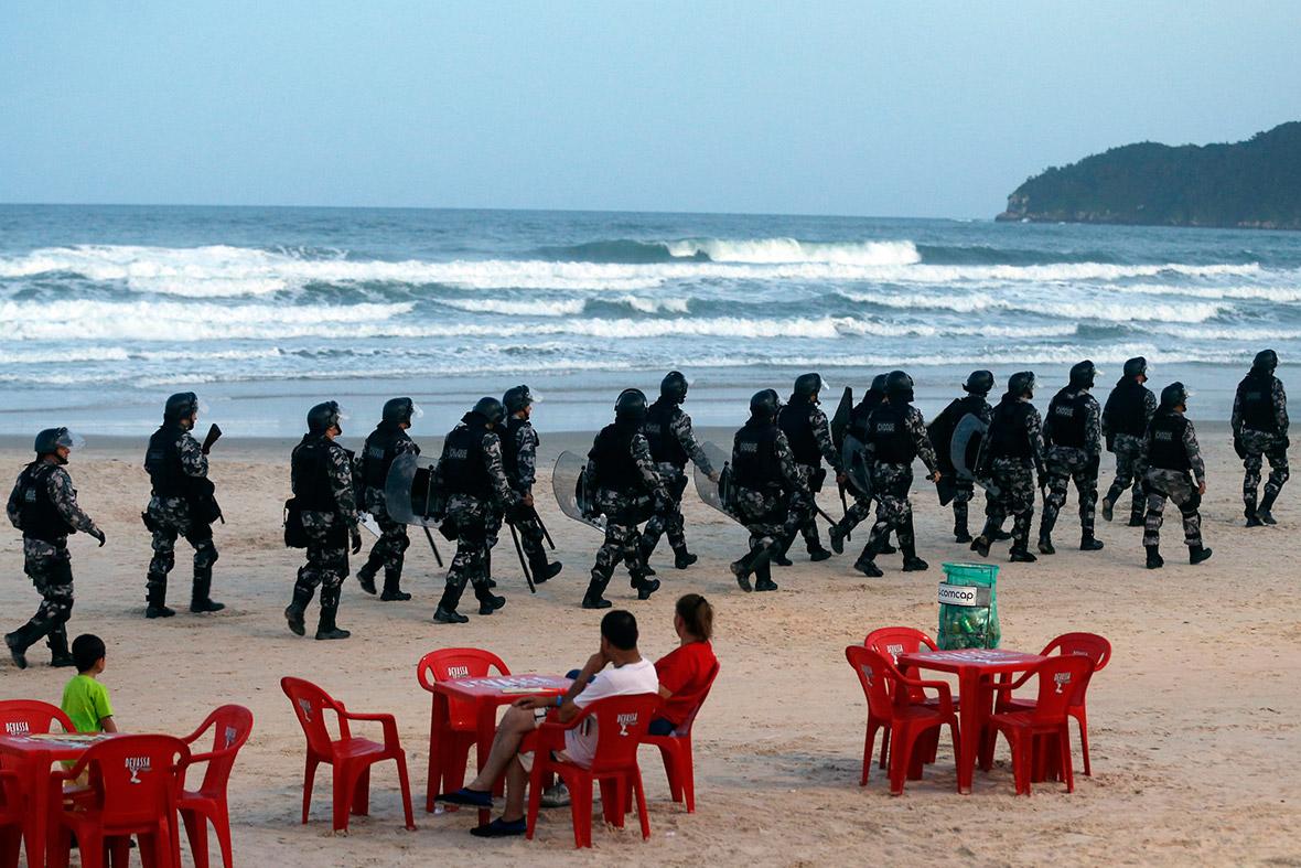 Riot police patrol the Santinho beach in Florianopolis, Santa Catarina state