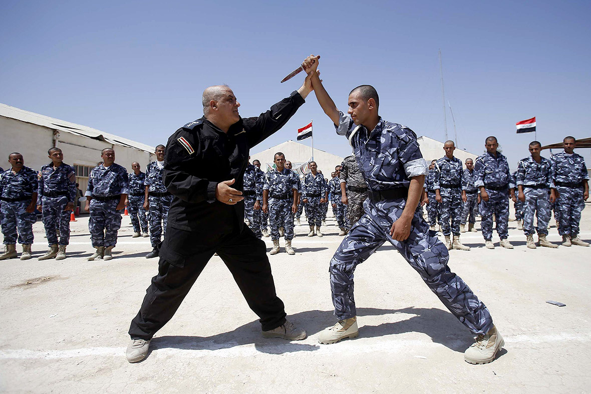 Newly recruited iraqi volunteers wearing police forces uniforms take