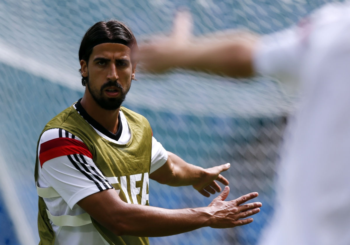Germany's Sami Khedira stretches during a training session at the Arena Fonte Nova stadium ahead of their 2014 World Cup against Portugal in Salvador,