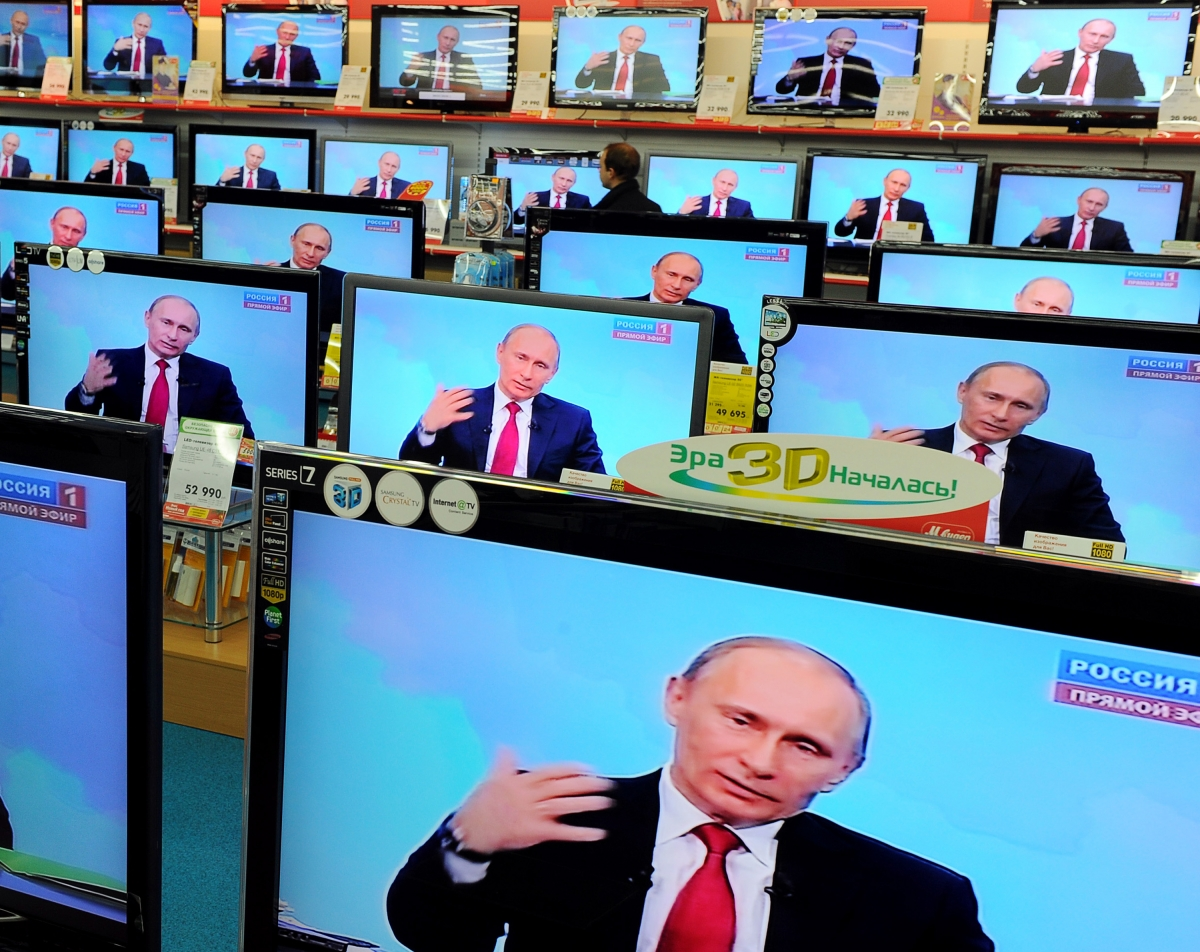 Russian president Vladimir Putin on television sets in a Moscow electronic goods store (Getty)