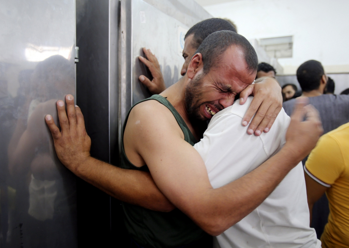 Palestinians mourn the death of their relatives