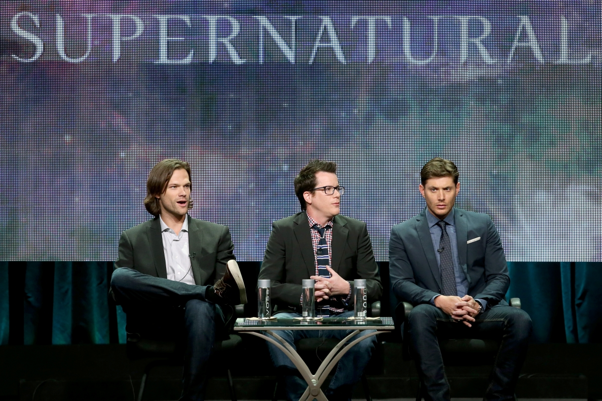 Jared Padalecki, producer Jeremy Carver, and actor Jensen Ackles speak onstage at the 'Supernatural' panel