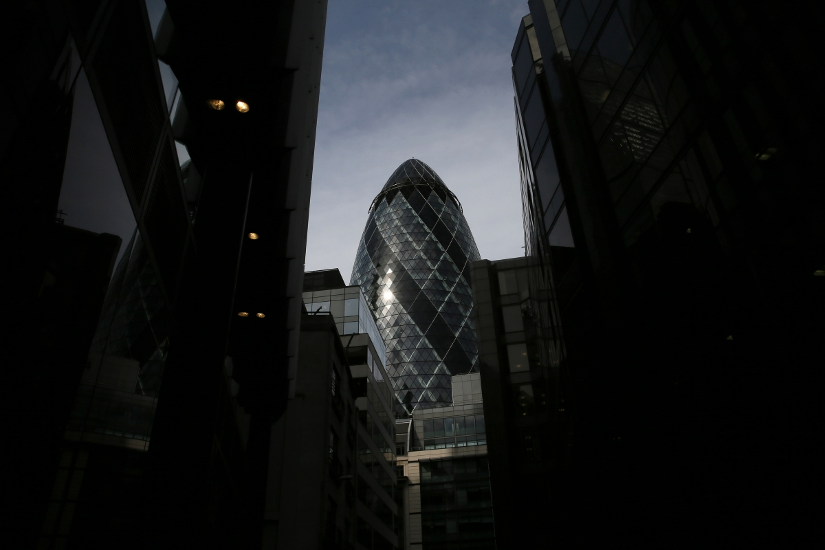 "The 30 St Mary Axe skyscraper, which is known locally as ""The Gherkin"" is seen in London"