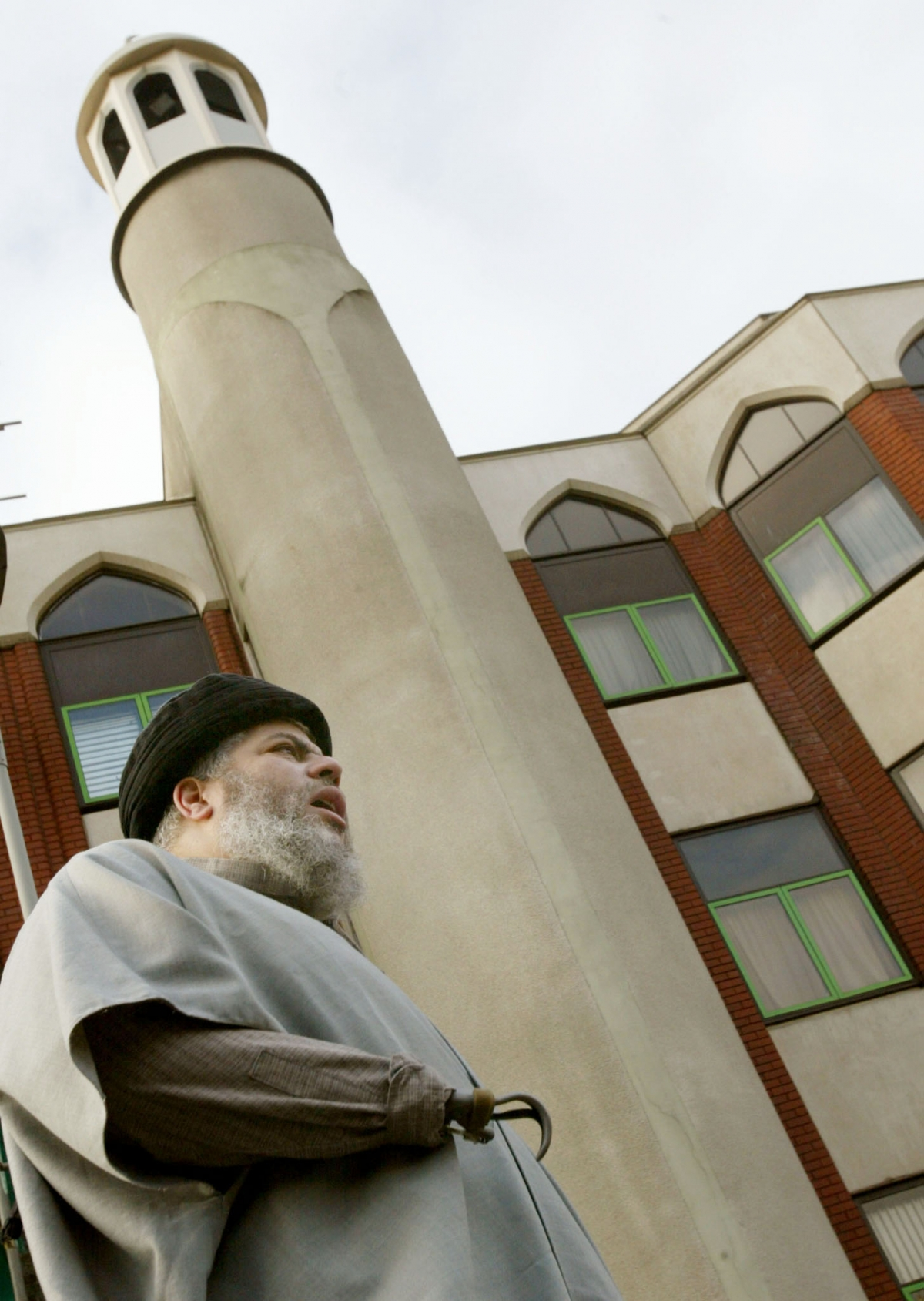 Muslim cleric,Abu Hamza al-Masri, leads prayers outside the N
