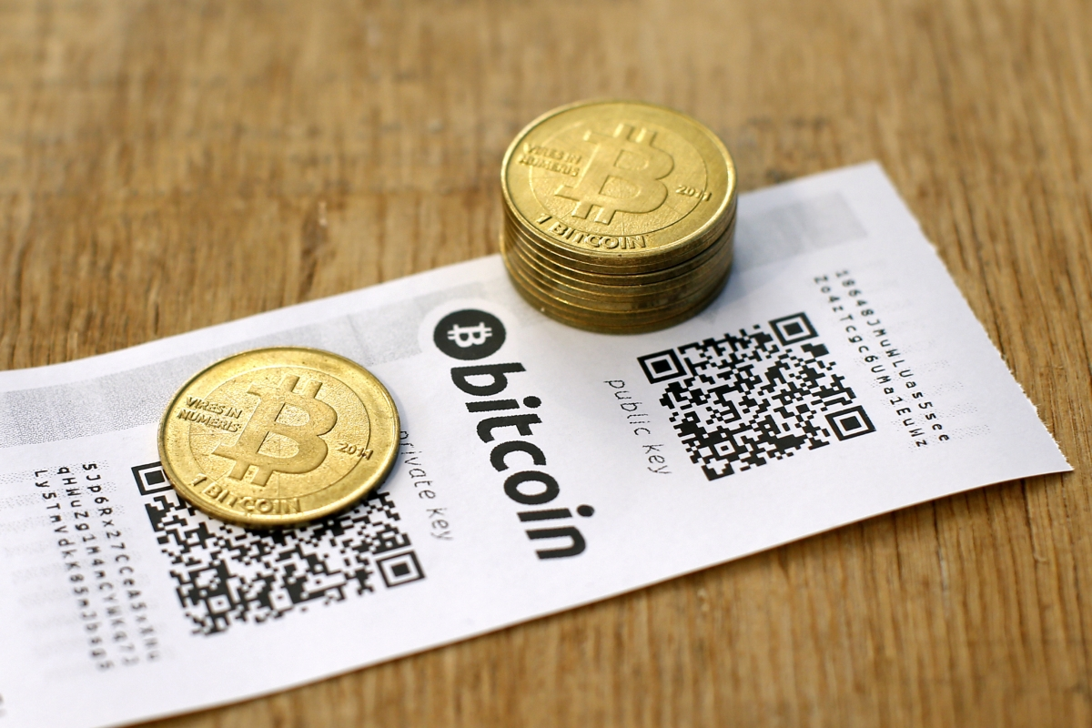 A Bitcoin (virtual currency) paper wallet with QR codes and coins are seen in an illustration picture tak