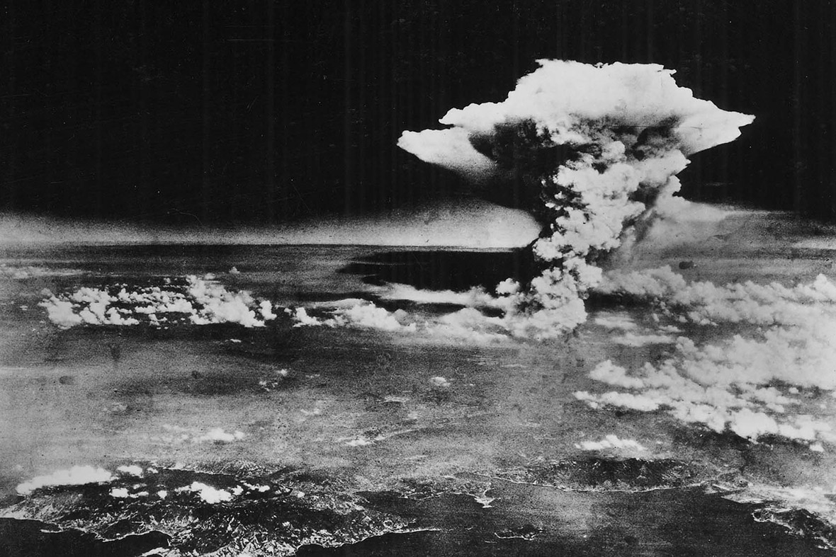 An atomic cloud mushrooms over Hiroshima, in this photo taken from the Enola Gay flying over Matsuyama, Shikoku