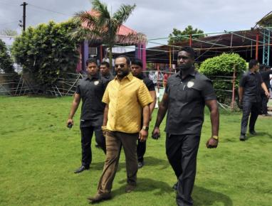 Indian politician wears gold shirt