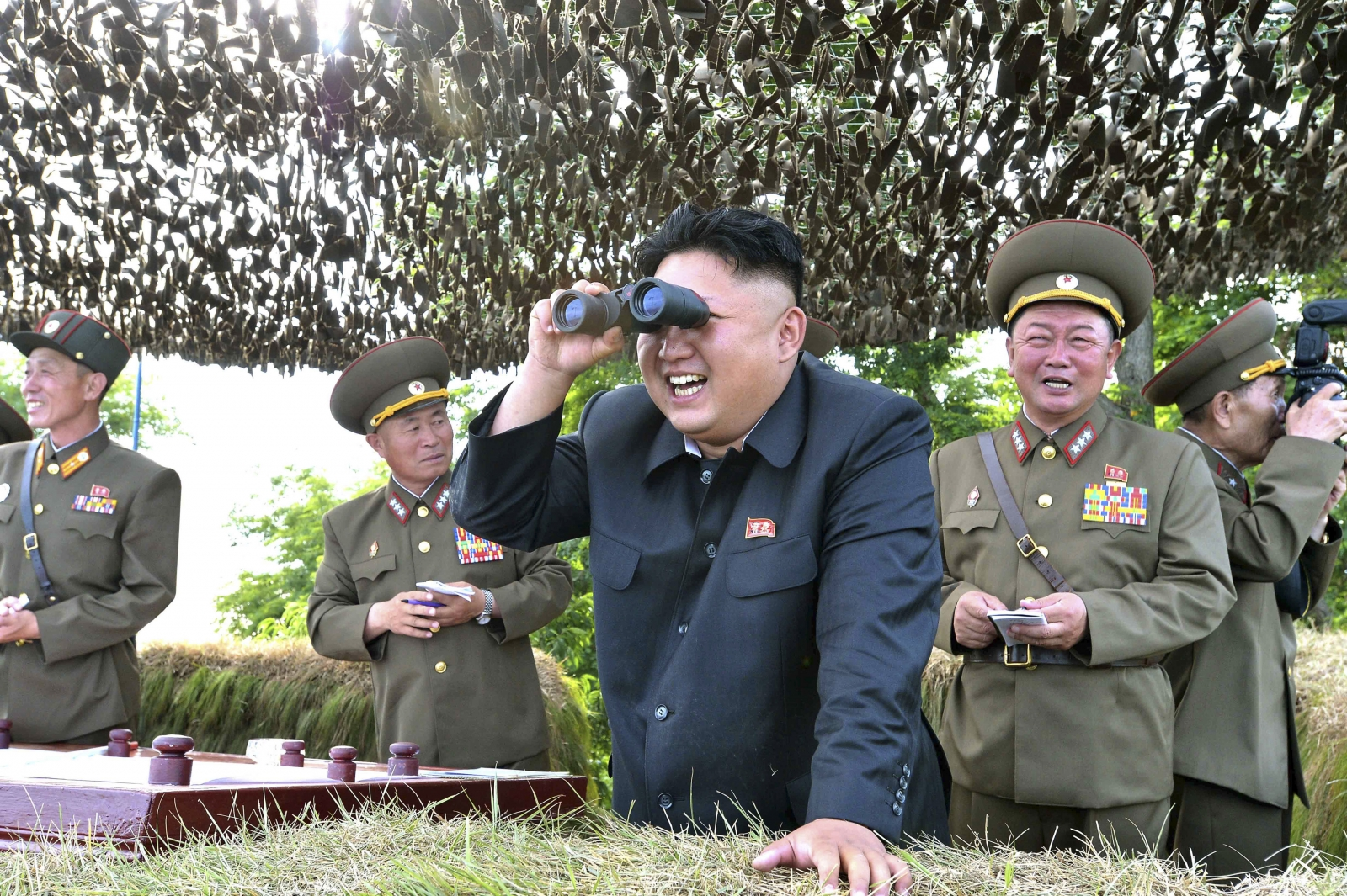 Kim Jong Un looks through binoculars