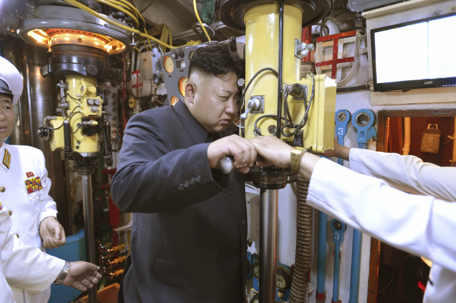 Kim Jong Un looks through a submarine periscope
