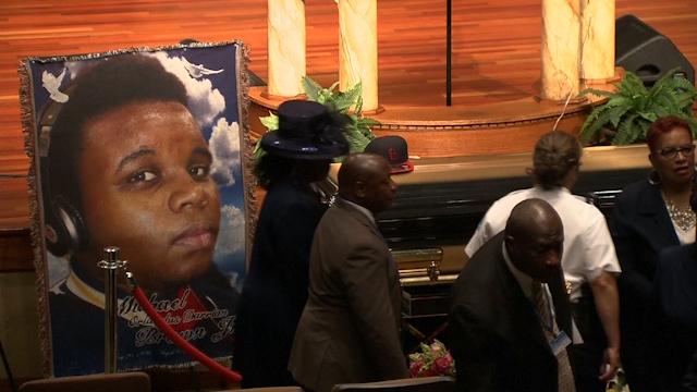 Mourners Gather for Funeral Services for Michael Brown