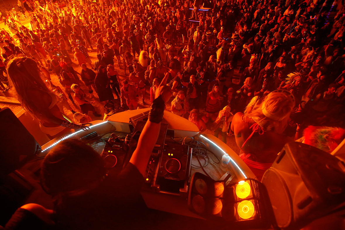 People dance as a DJ performs in the Dancetronauts mutant vehicle