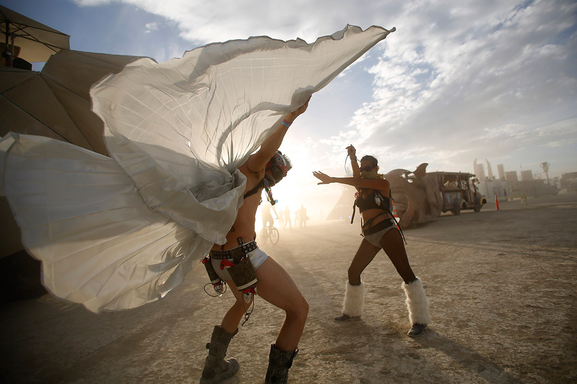 Dillon Bracken (L) and Atalya Stachel dance during the Burning Man 2014