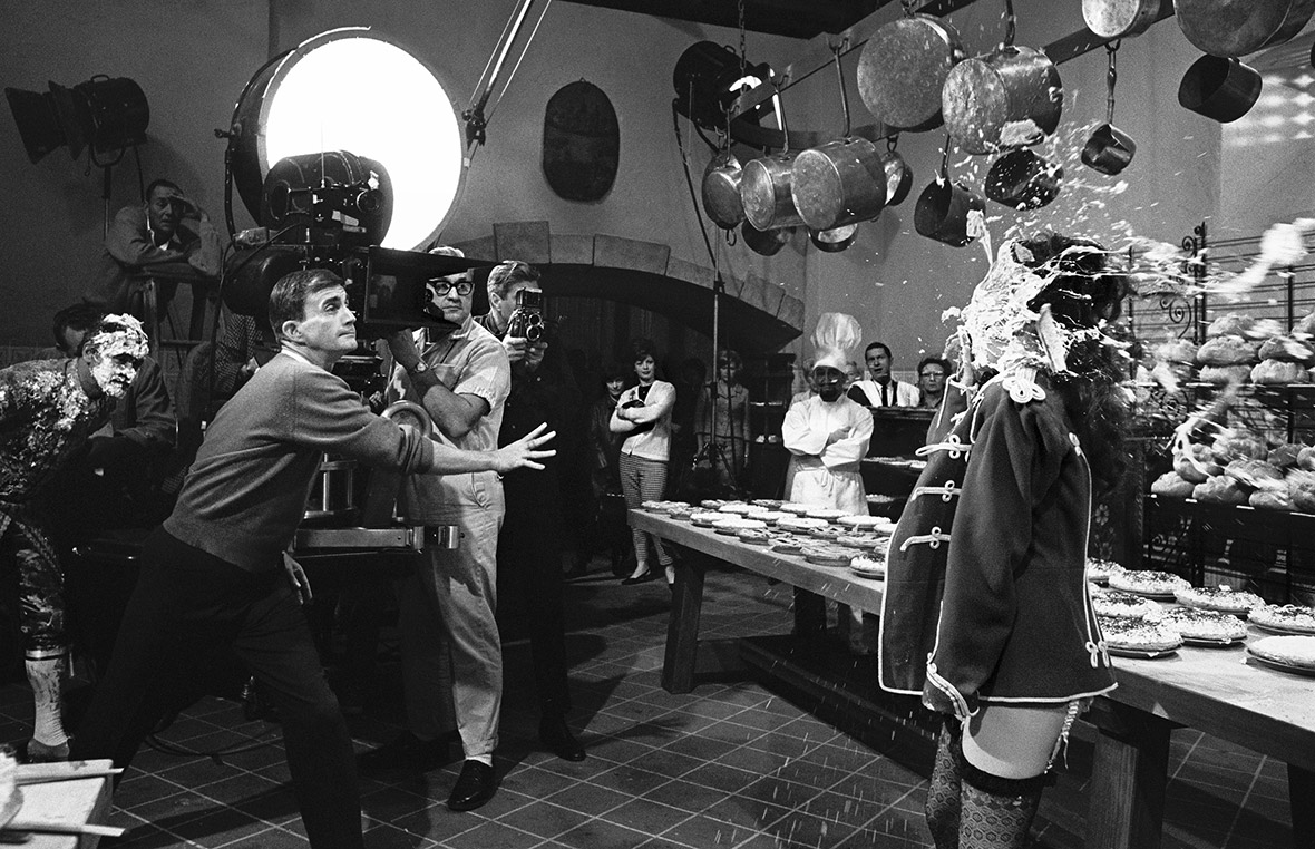 Blake Edwards hurling a custard pie at Natalie Wood's face on the set of The Great Race, 1964
