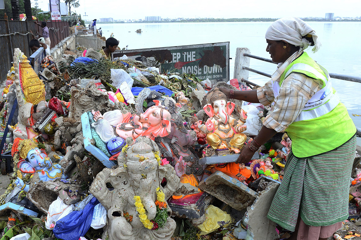 Workers remove statues of Lord Ganesh from the Hussain Sagar Lake in Hyderabad