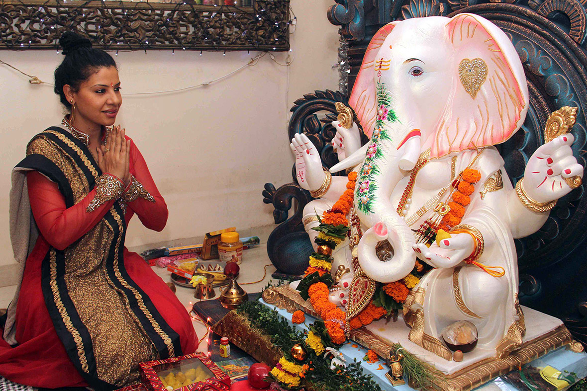 Bollywood actress Rani Mukherjee offers prayers in front of an idol of Hindu god Lord Ganesh in Mumbai