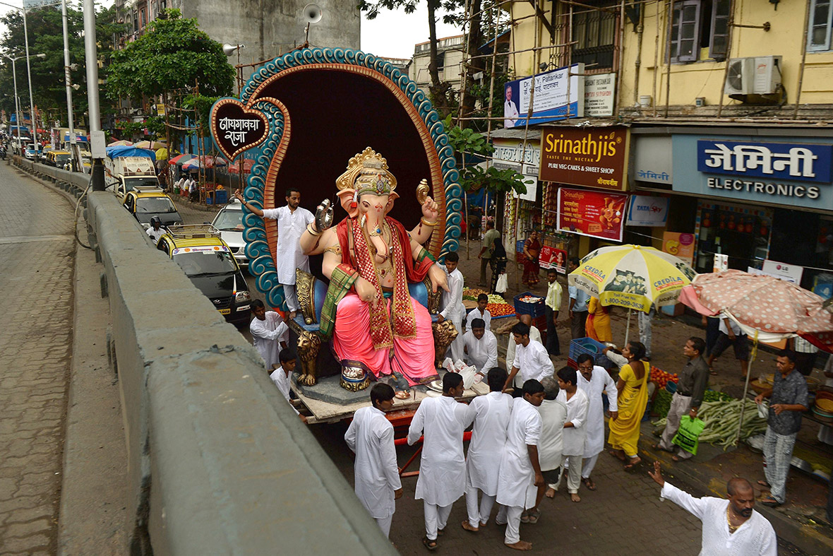 Hindus transport a huge idol of the elephant-headed Lord Ganesh towards the sea in Mumbai