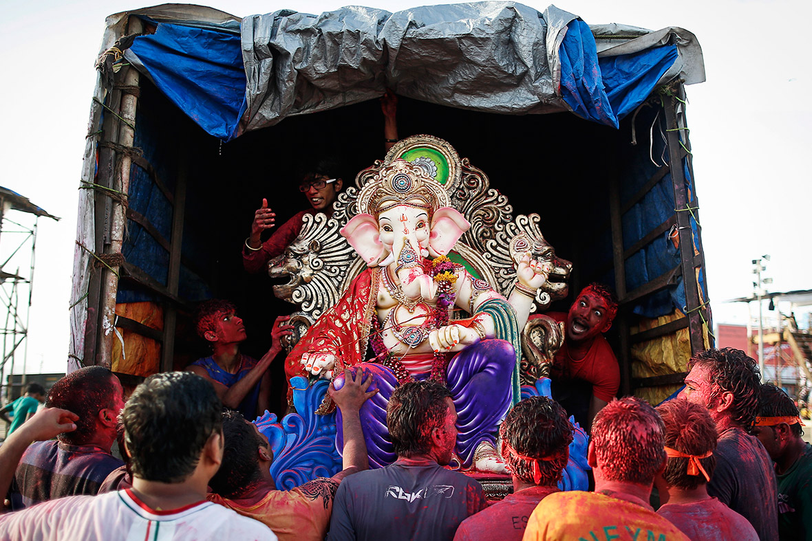 Devotees unload an idol of the Hindu god Ganesh, the deity of prosperity, to be immersed into the Arabian Sea in Mumbai