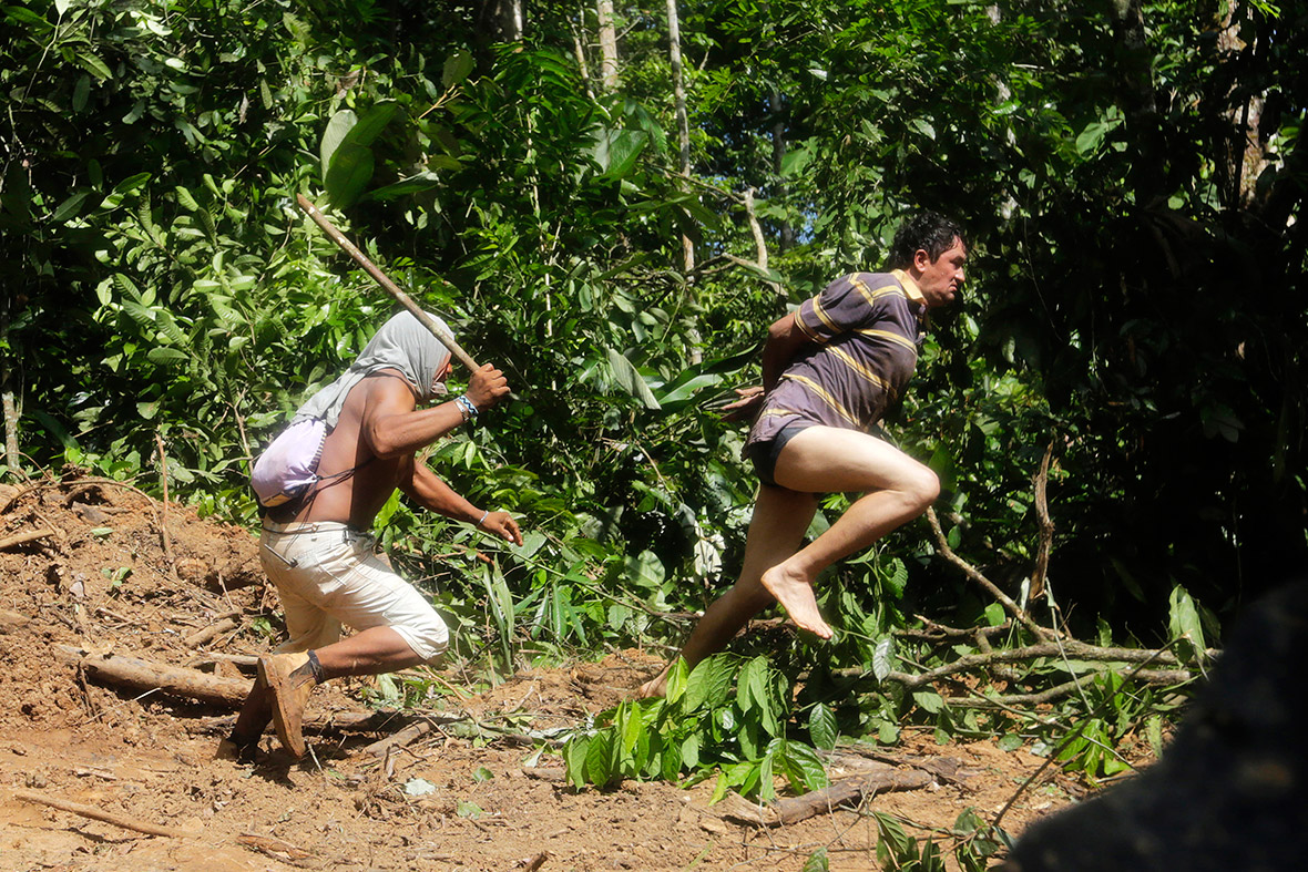 A Ka'apor warrior chases a logger who tried to escape after he was captured