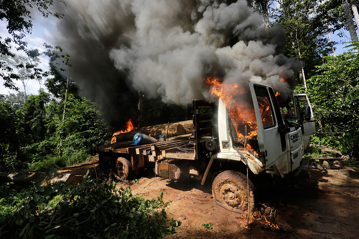 A logging truck burns after it was set on fire by Ka'apor warriors in the Amazon