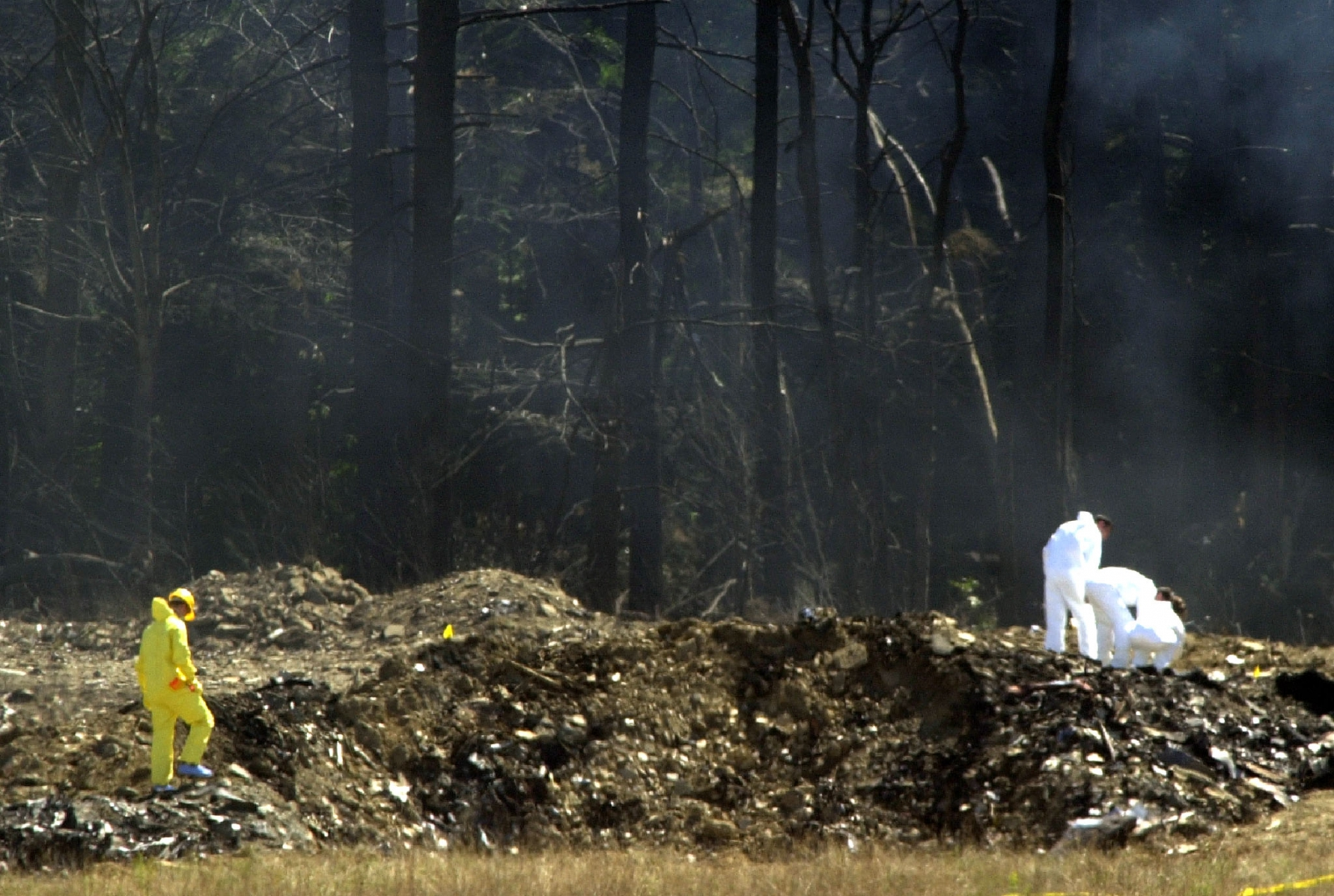 Workers comb the wreckage of Flight 93