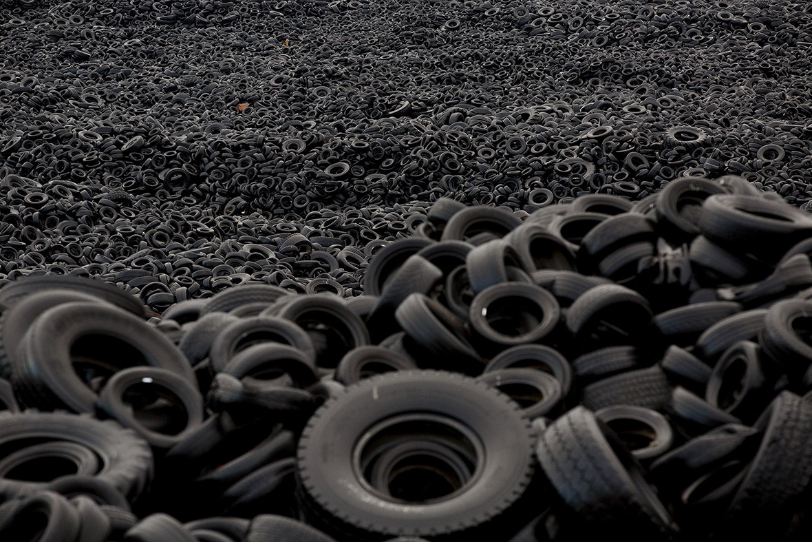 Millions of old tyres are dumped near empty apartment for Uses for old tyres