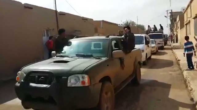 Dead IS Fighters Paraded through Streets of Ras al-Ayn