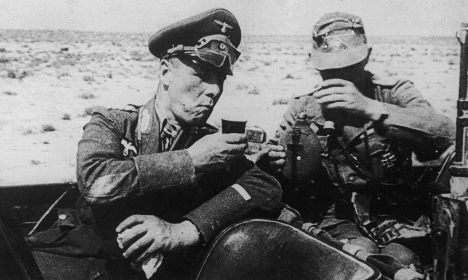 German field marshal Erwin Rommel takes refreshment  in the Lybian desert during the 1941 campaign