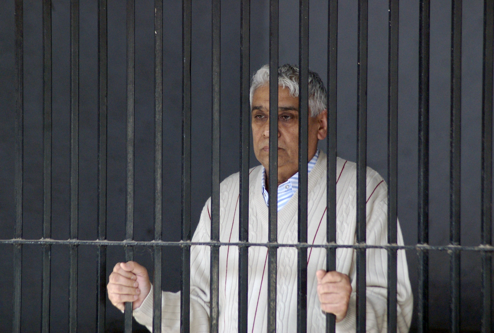 Satguru Rampalji Maharaj in police custody, after being arrested in relation with a 2006 murder case. (Reuters)
