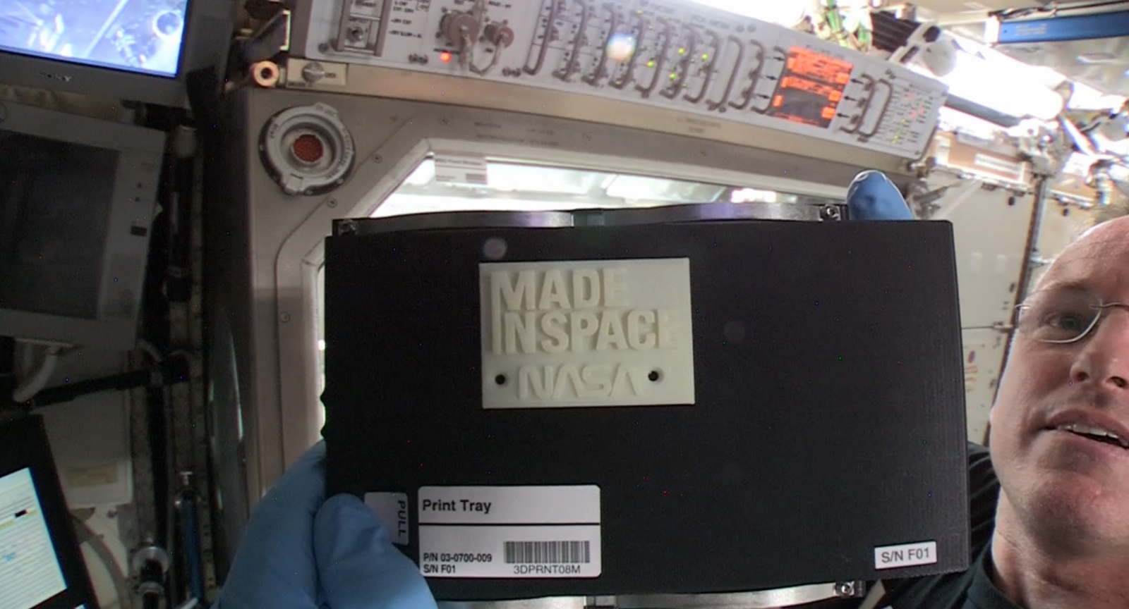 "Nasa astronaut Barry ""Butch"" Wilmore holds up the first ever 3D-printed item in space"