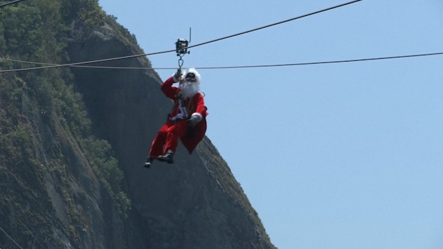 Extreme Santa zip-lines down Rio's iconic Sugarloaf Mountain