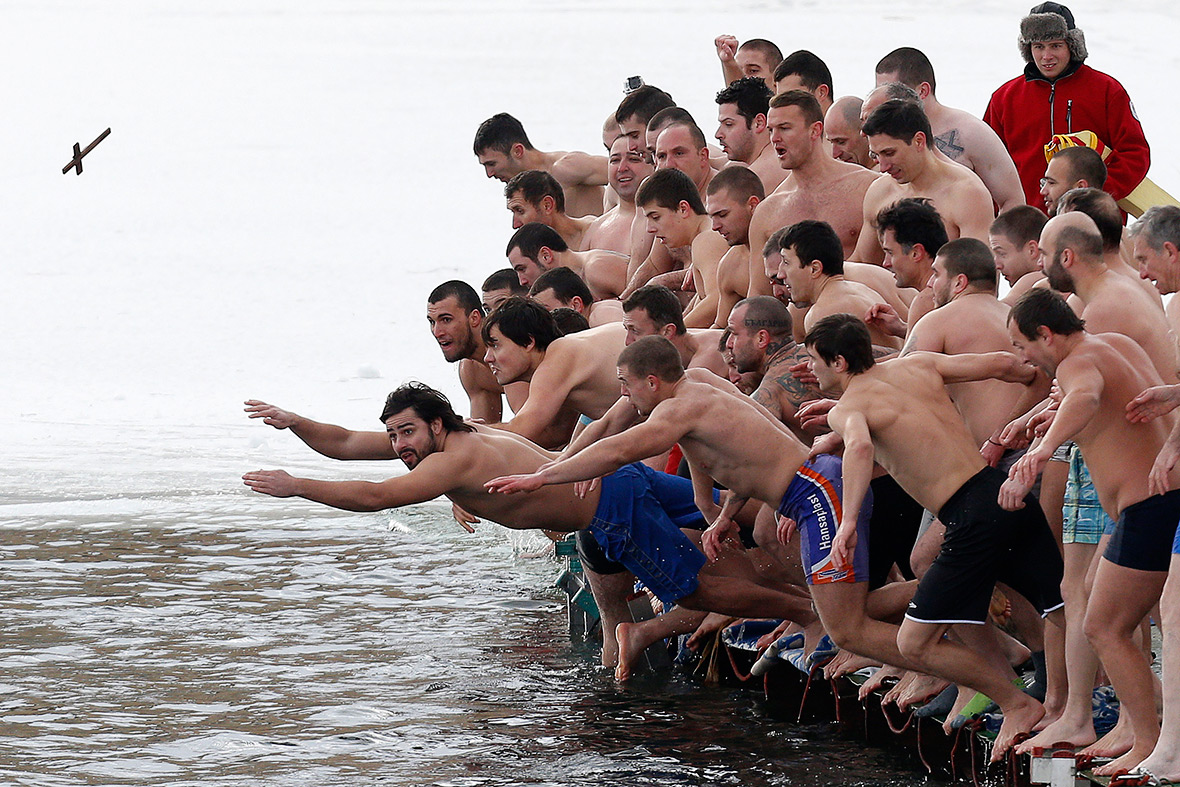 Bulgaria: Men jump into the waters of a lake in Sofia in an attempt to grab a wooden cross on Epiphany Day