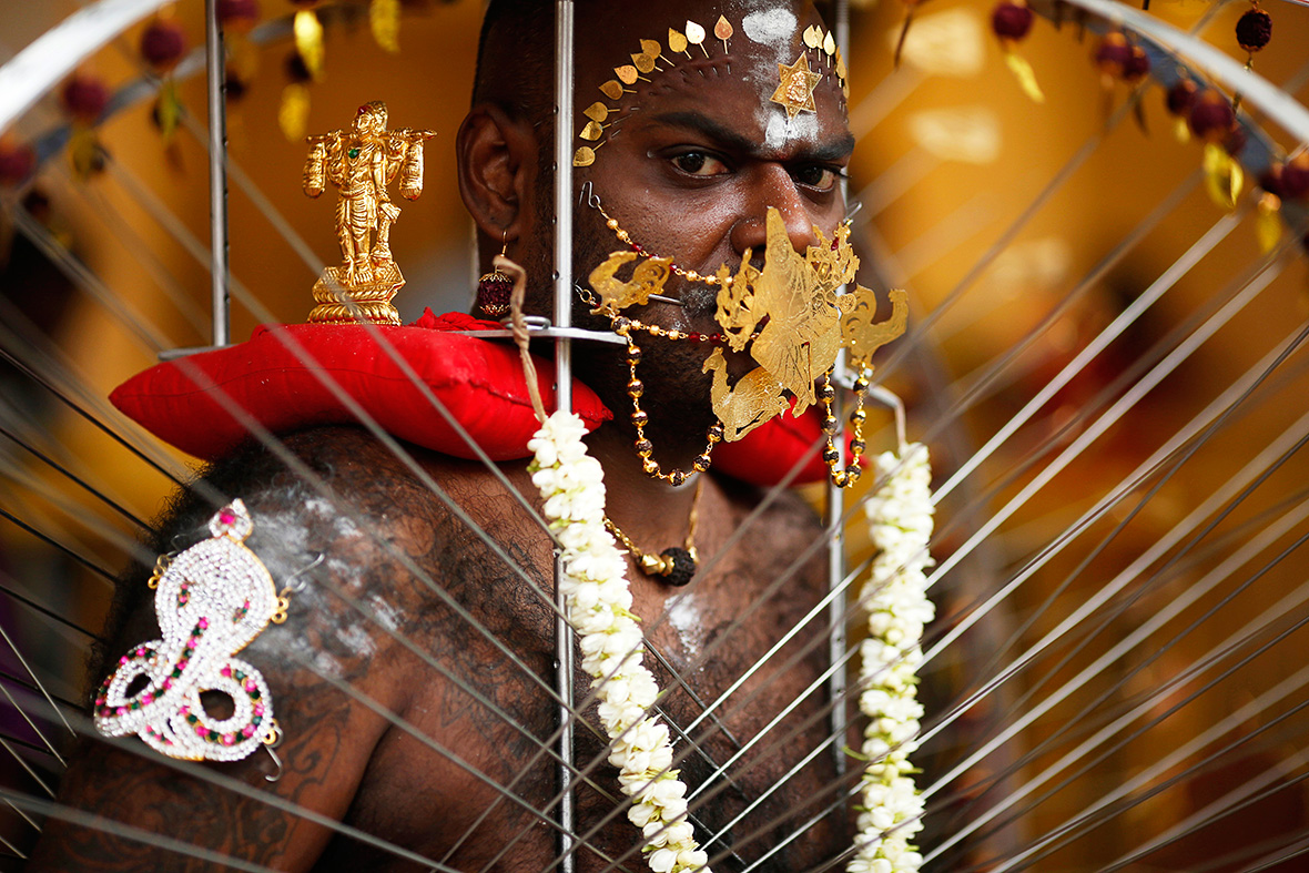 thaipusam festival hindus with facial and body piercings
