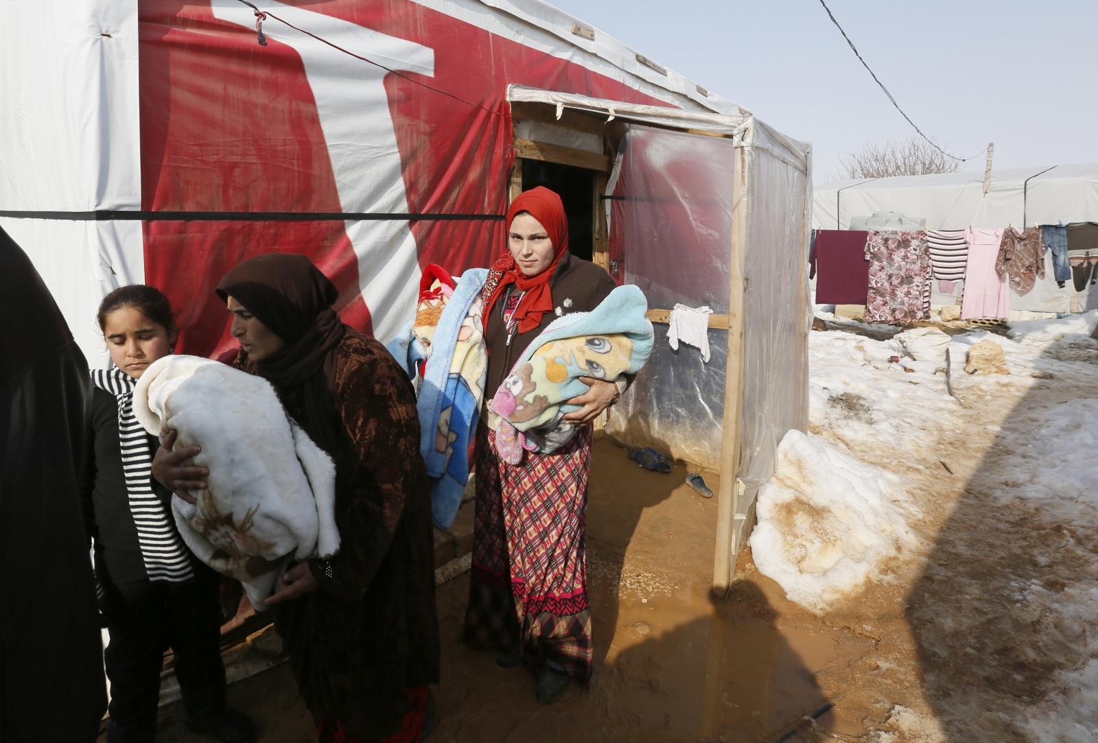 [Image: syrian-refugee-family.jpg]