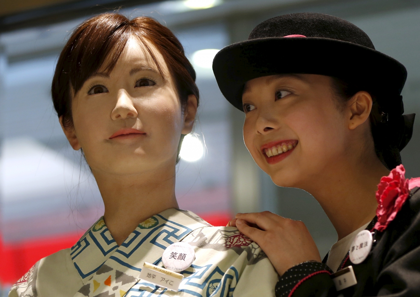 Humanoid robot woman directs customers around department store…